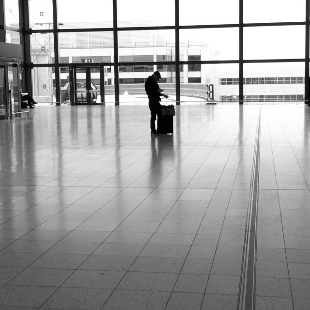 """Lone figure at Gatwick Airport"" stock image"