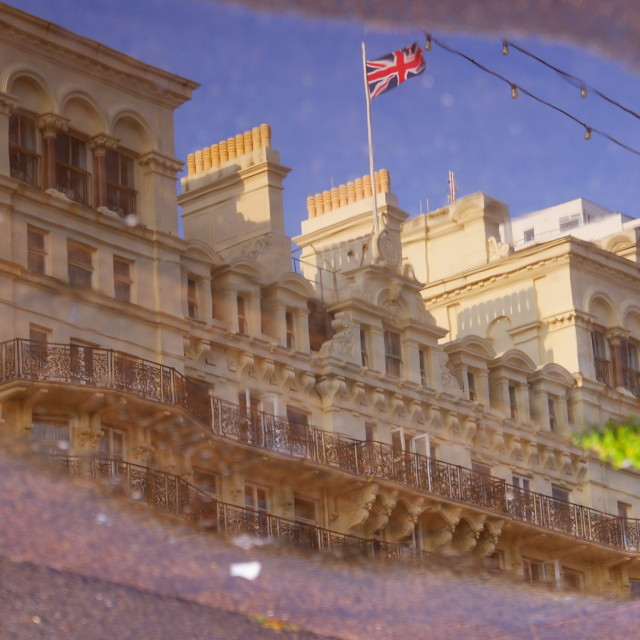 """The Grand Hotel Brighton, reflected in a puddle"" stock image"