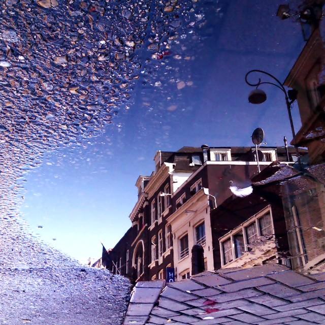 """Amsterdam puddle reflection"" stock image"