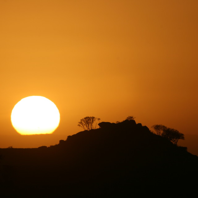 """Sunrise over the Serengeti"" stock image"
