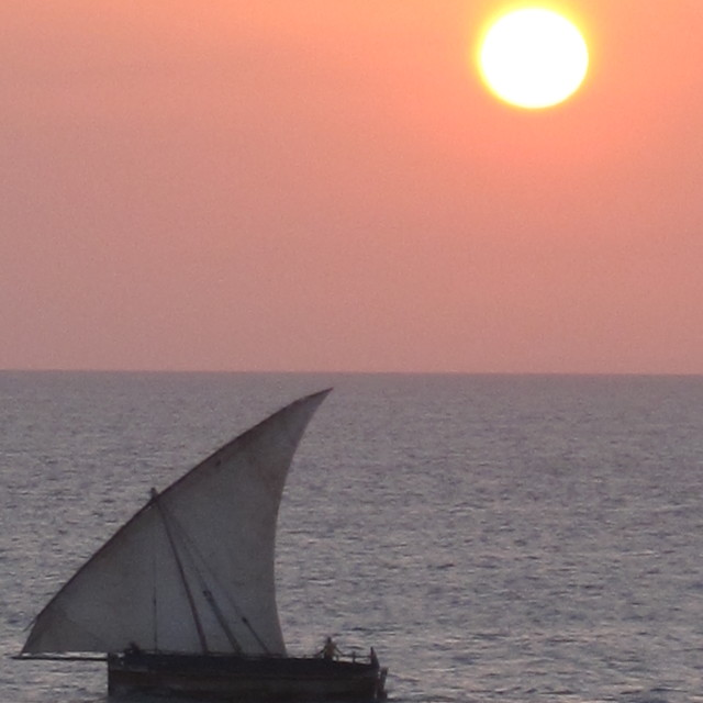 """A dhow in Zanzibar at sunset"" stock image"