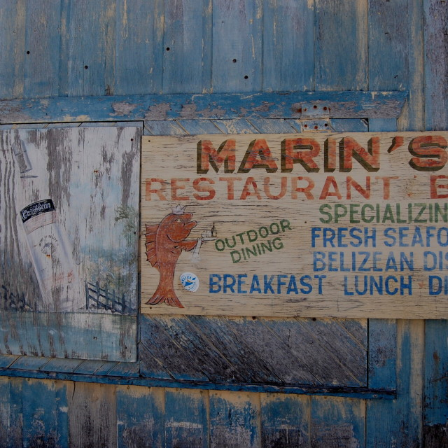 """Faded restaurant sign in Belize"" stock image"