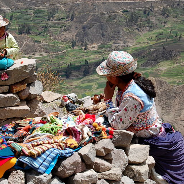"""Lady sells wares on rocks"" stock image"