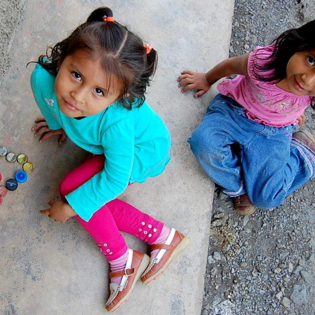 """""""Girls playing in Peru"""" stock image"""