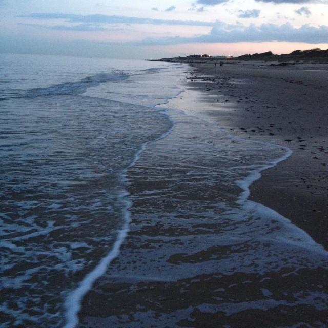 """Evening walk on the beach"" stock image"