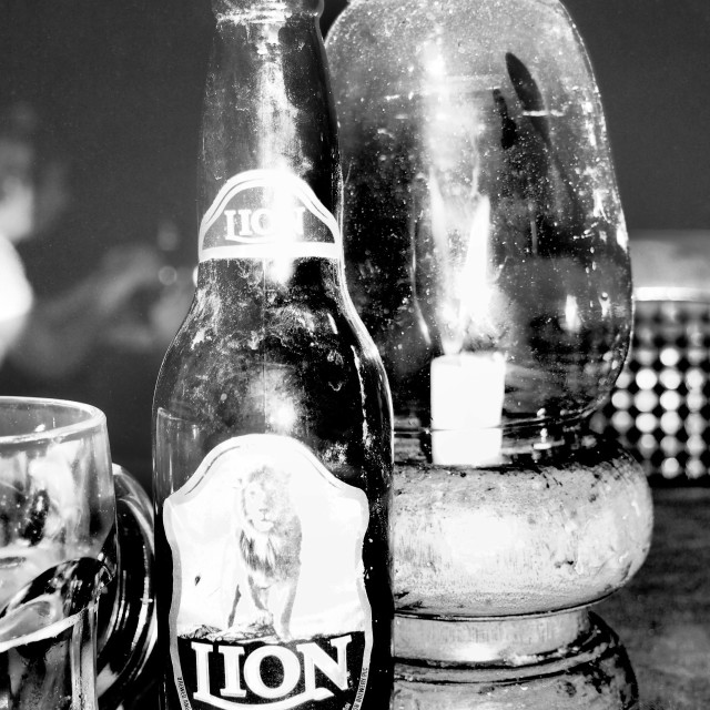 """Lion beer and candle, Sri Lanka"" stock image"