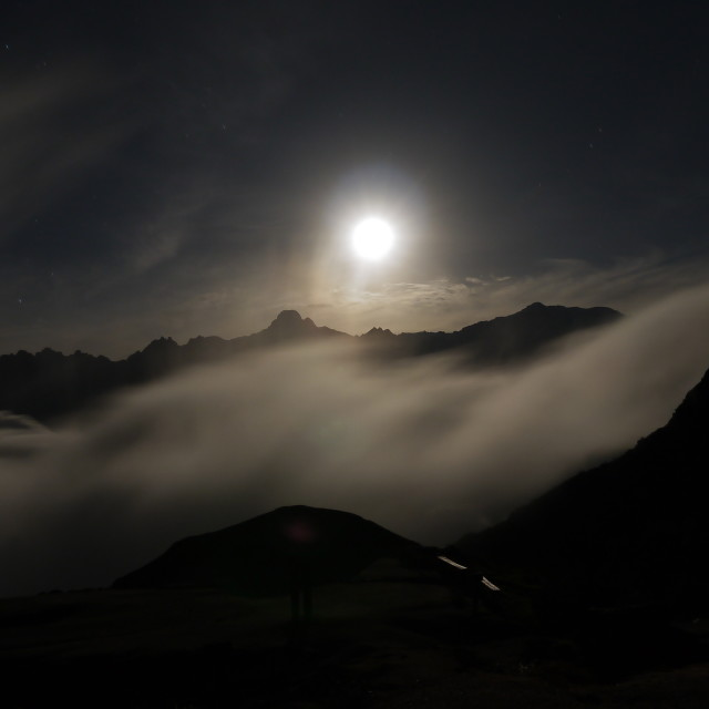 """Full moon rises over the Andes"" stock image"