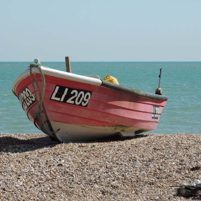 """Red Fishing Boat on seafront"" stock image"