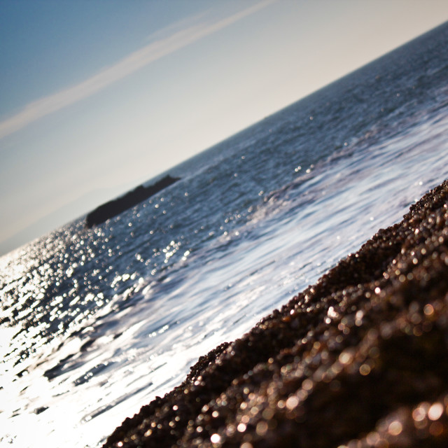 """Blue sky, sea and pebble sand"" stock image"