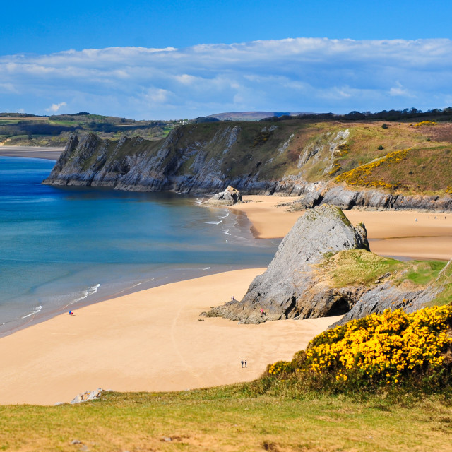 """Pobbles and Three Cliffs Bay"" stock image"