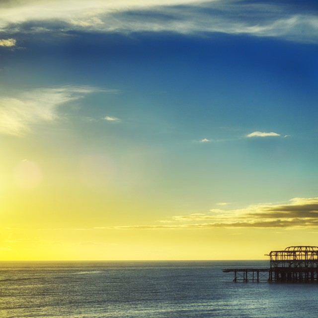 """Brighton West pier and sunset"" stock image"