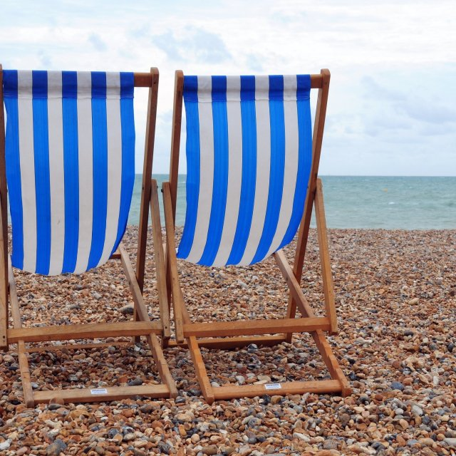 """Deck Chairs On The Beach"" stock image"