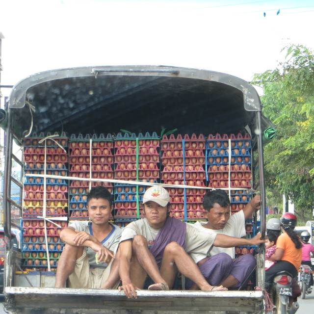 """Burmese lads on an egg truck"" stock image"