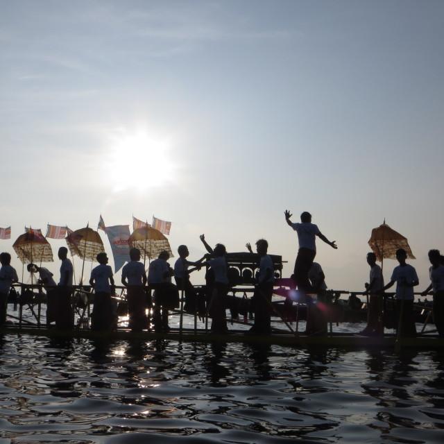 """Myanmar/Burma:-Inle Lake leg rowers at the Bhudda procession"" stock image"