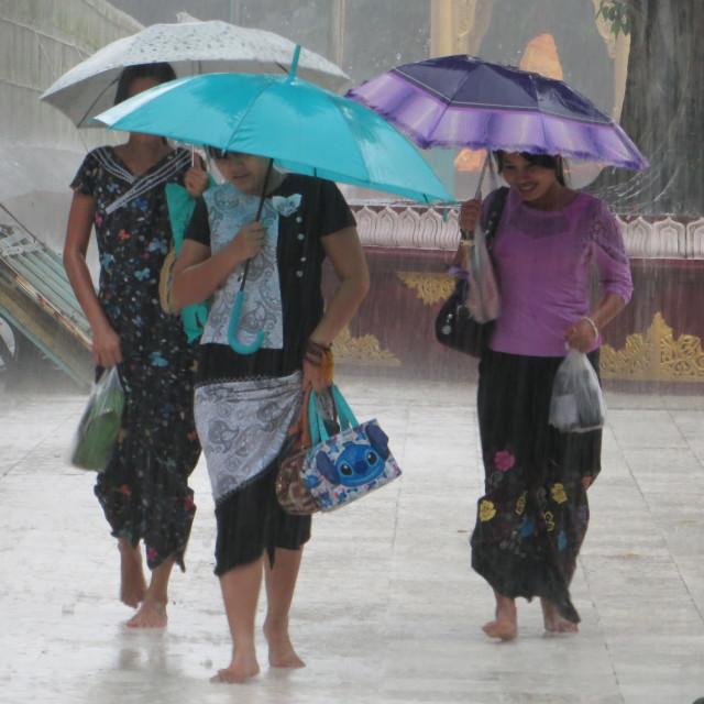 """Rangoon girls caught in the rain at the Shwedagon Pagoda"" stock image"