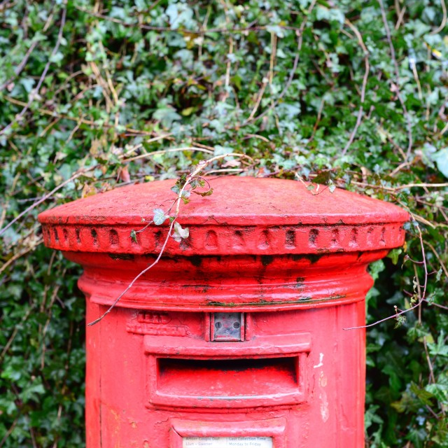 """Battered old village post box"" stock image"