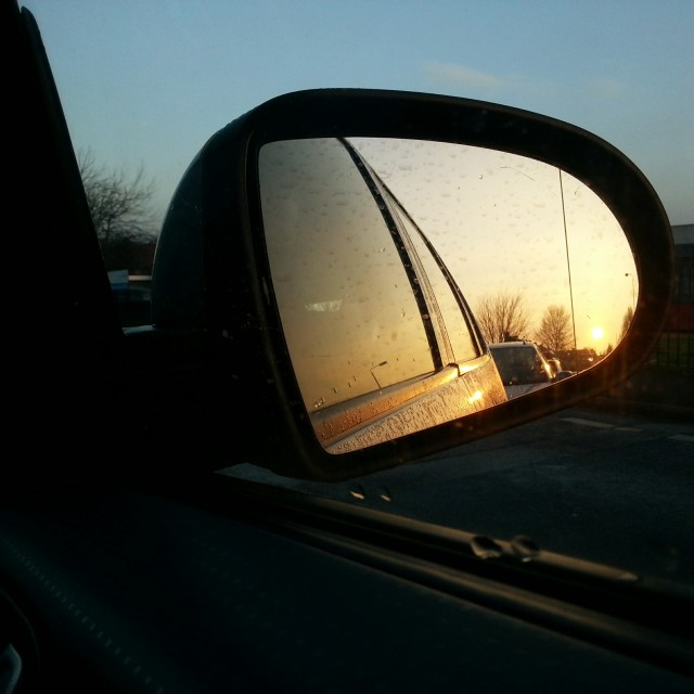 """Sunrise in Car Mirror"" stock image"