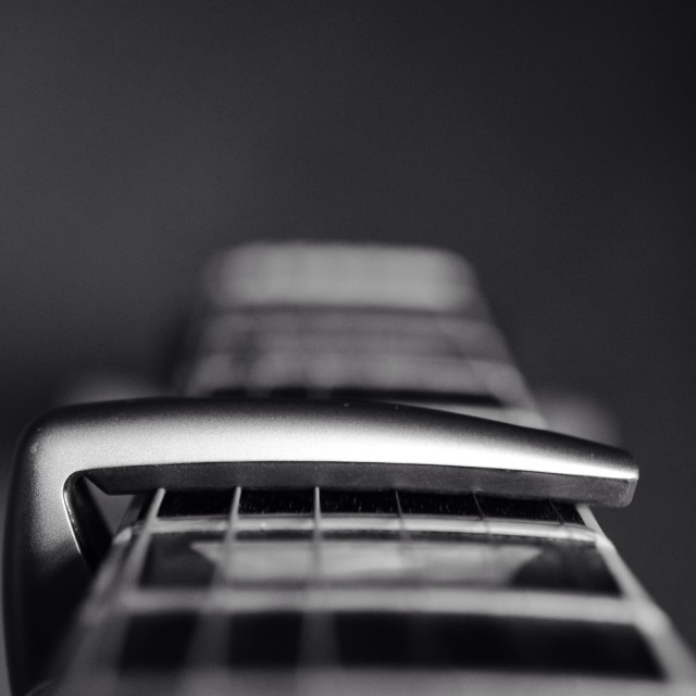 """Guitar neck with capo"" stock image"