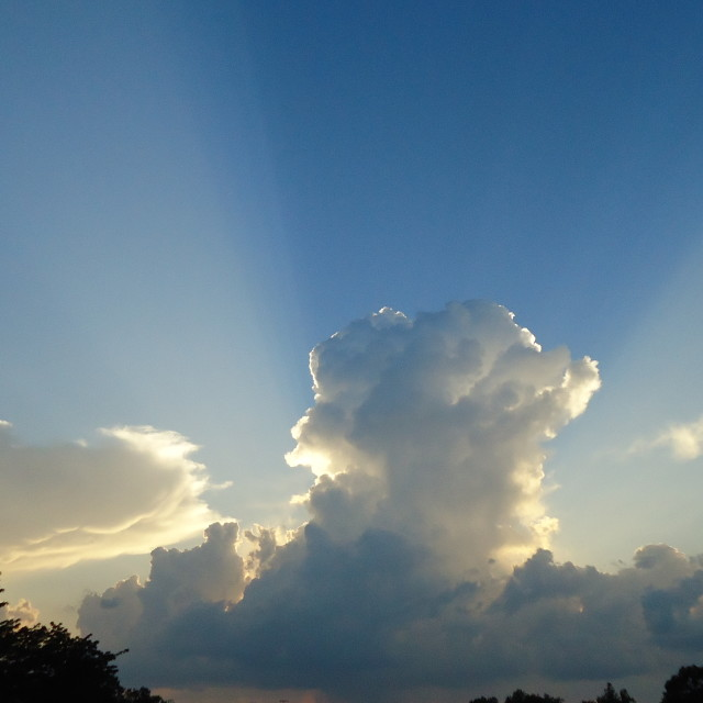 """Clouds and sun"" stock image"