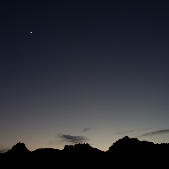"""Venus and the moon in the desert"" stock image"