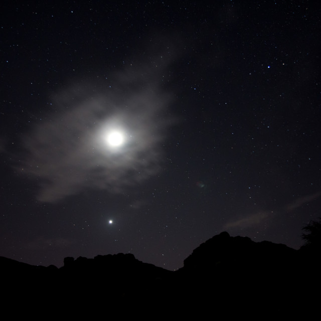 """Cloudy moon, venus and the stars"" stock image"