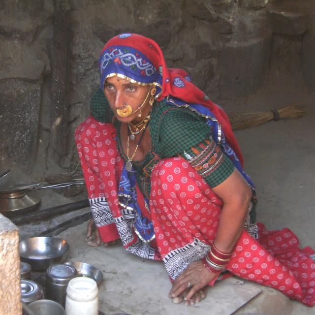 """Woman preparing food, Indian village"" stock image"