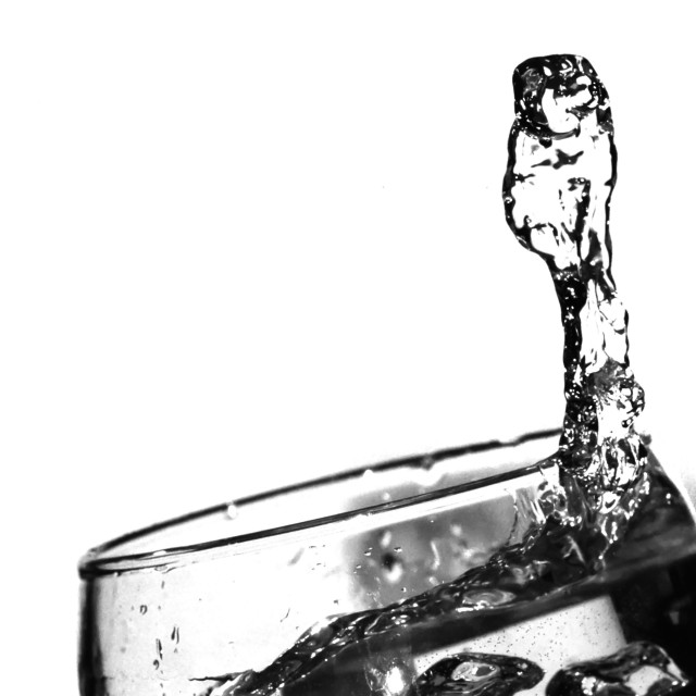 """""""Water splash in a glass"""" stock image"""