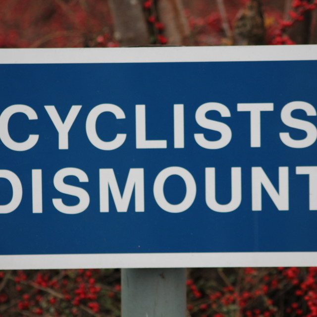 """Cyclists Dismount instruction sign"" stock image"