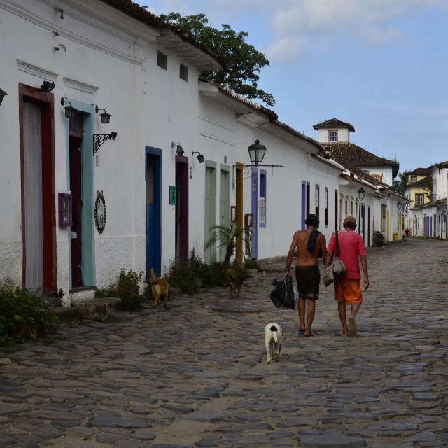 """Men and Dogs paraty, Brazil"" stock image"