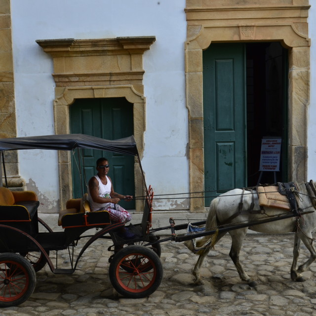 """Igreja da Matriz and horse carriage"" stock image"