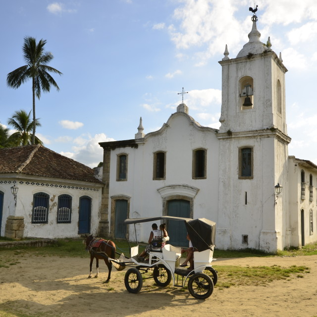 """Horse carriage and Brazilian church"" stock image"