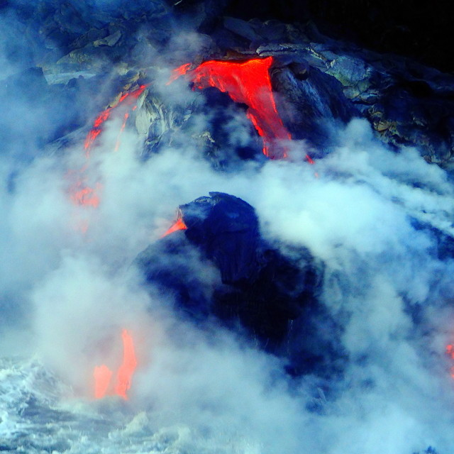 """Lava flowing into the Ocean"" stock image"