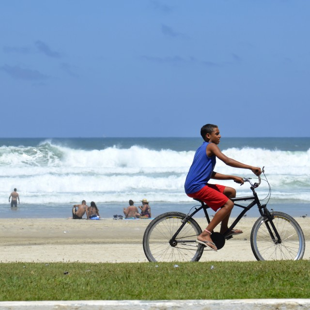 """Cyclist on the beach"" stock image"