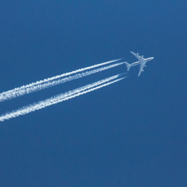 """Aircraft with Contrails"" stock image"