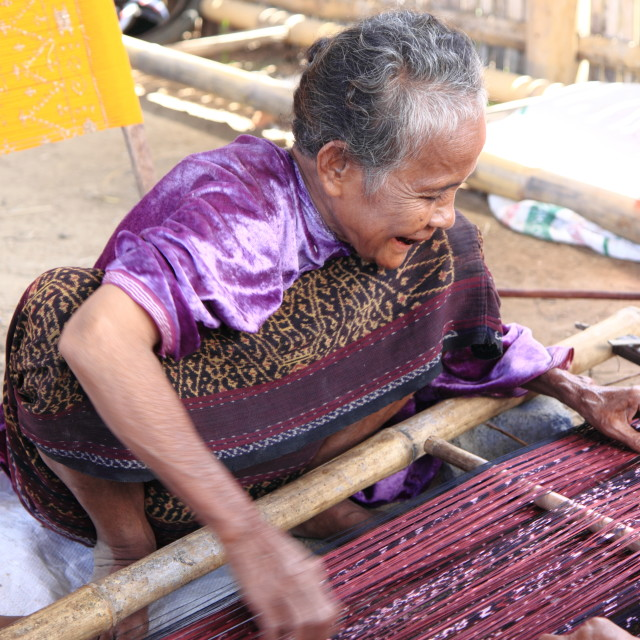 """Old lady weaving Flores Indonesia"" stock image"