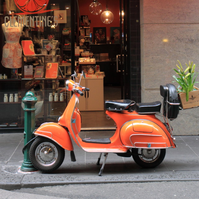 """Orange Vespa motorbike"" stock image"