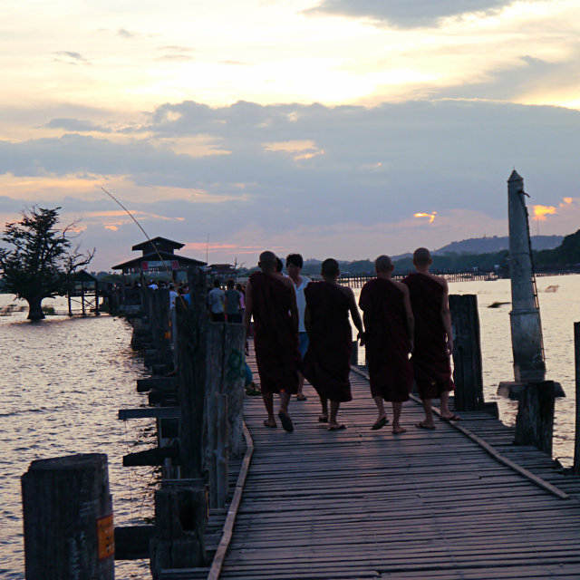 """Monks on a bridge"" stock image"