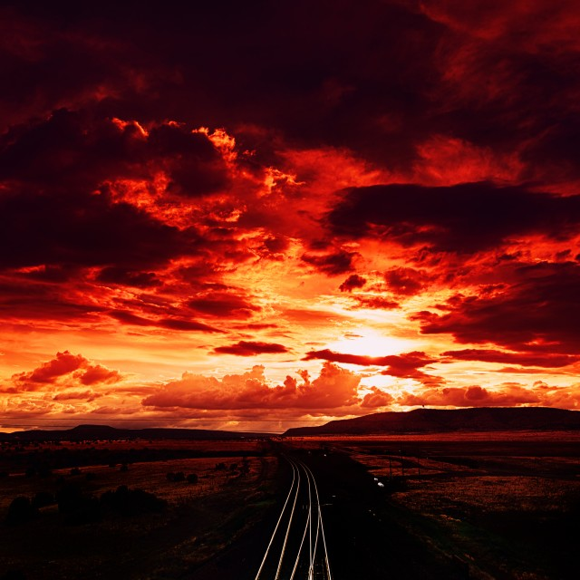 """Fiery Skies on Route 66 Railway in Arizona"" stock image"