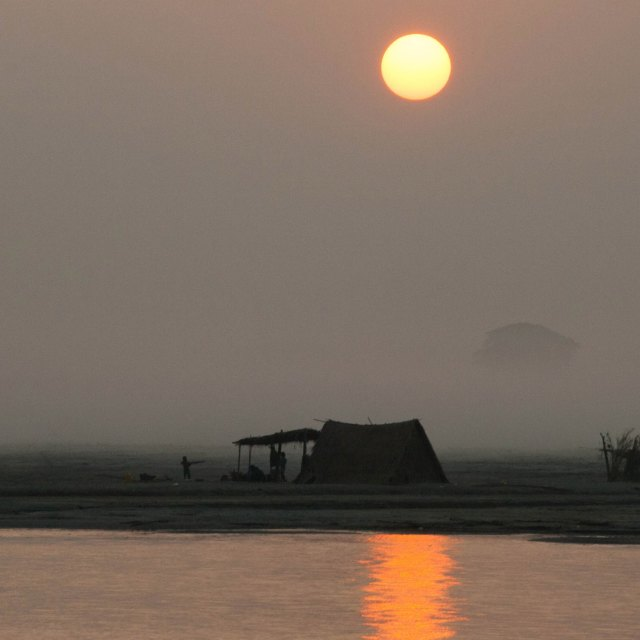 """""""A tent pitched on the banks of the Irrawadday, Burma"""" stock image"""