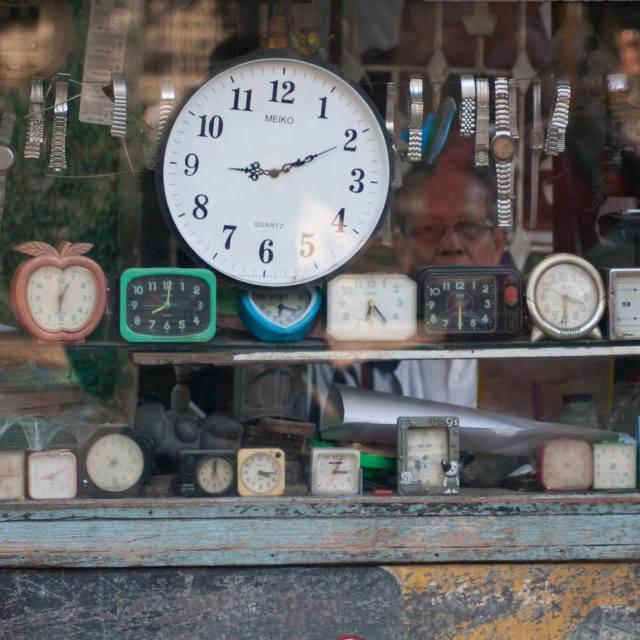 """""""A man selling clocks in Mandalay, Myanmar"""" stock image"""