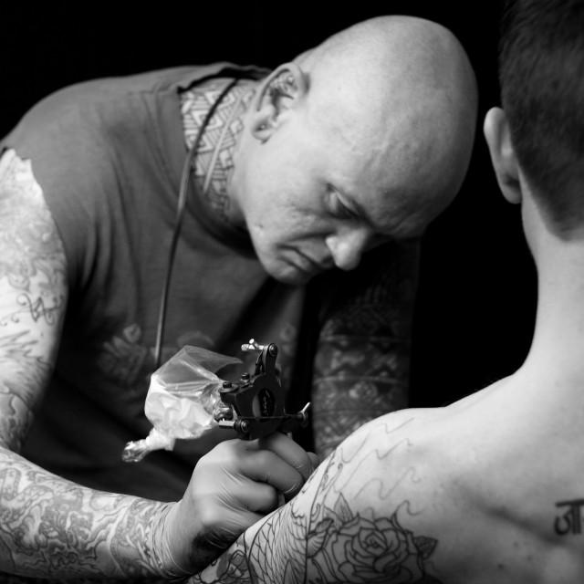 """Tattooist at Work"" stock image"