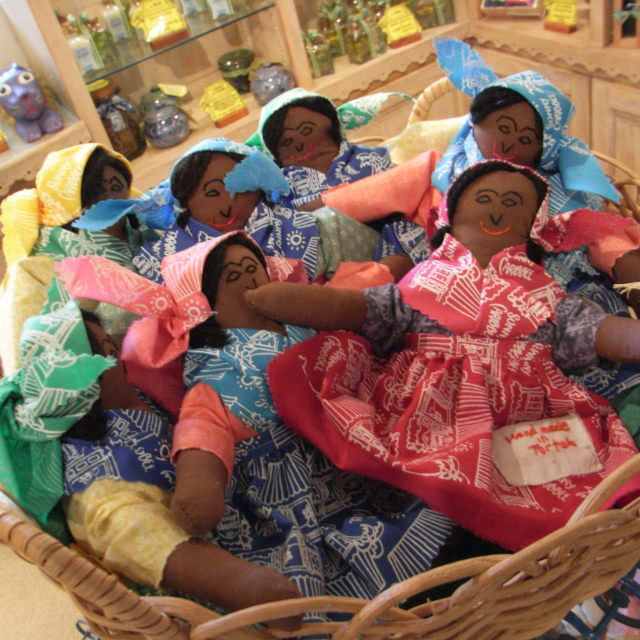 """Dolls in a Basket"" stock image"