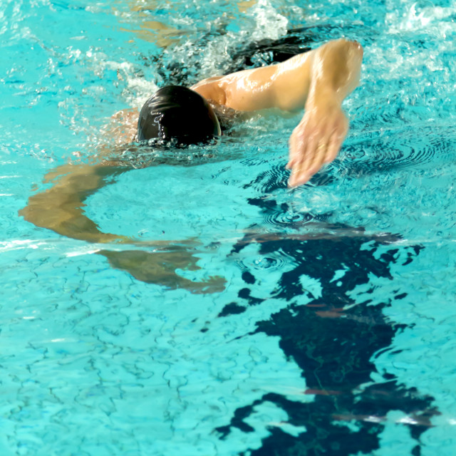 """Man swimming"" stock image"