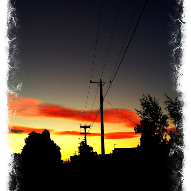 """Tasmanian Power Lines at Sunset"" stock image"