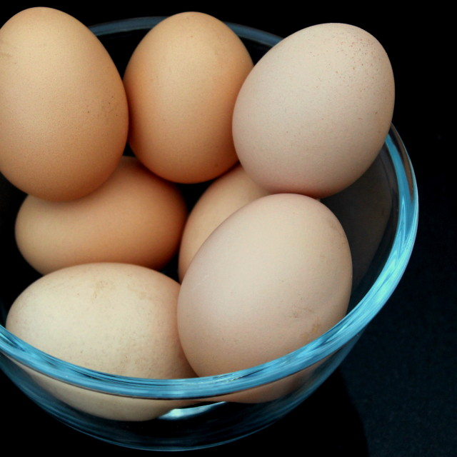 """7 Eggs in a glass bowl"" stock image"