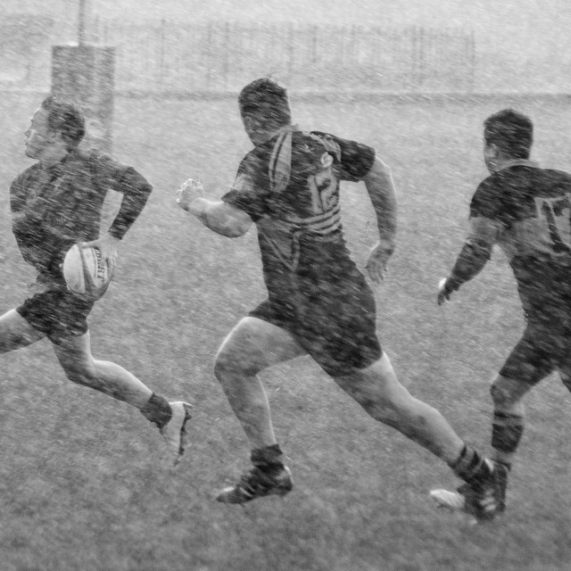 """Rugby in the snow"" stock image"