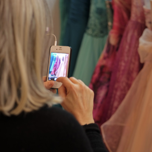 """PHOTOGRAPHING DRESSES"" stock image"