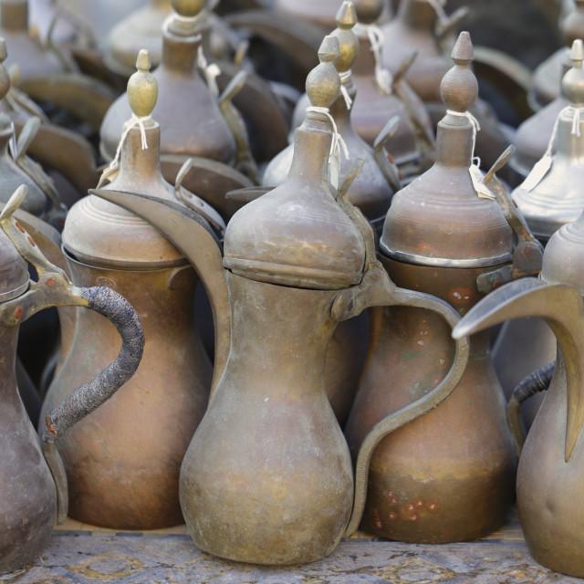 """Arabian coffee pots in Qatar souk"" stock image"
