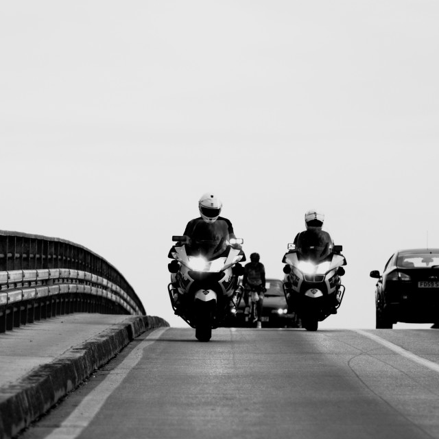 """Cops and bridge"" stock image"