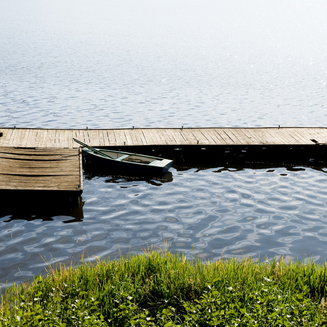 """""""dilapidated boat moored"""" stock image"""